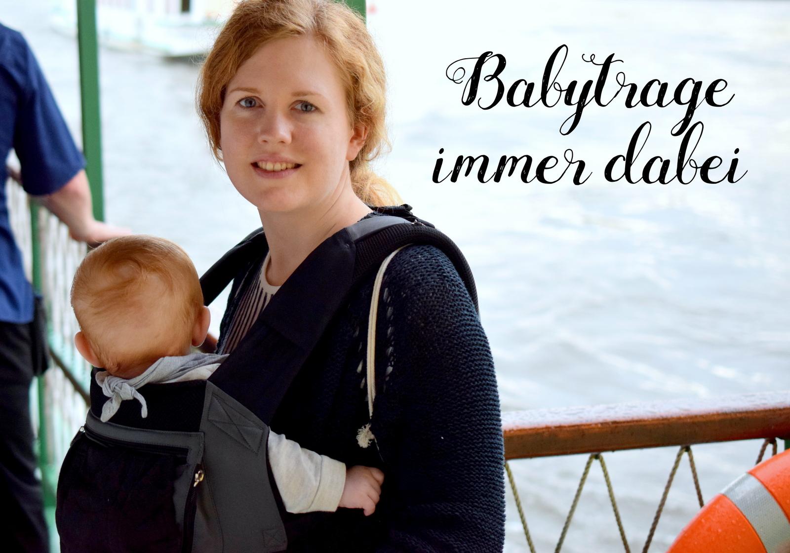 Verreisen mit Baby ist mit einer Babytrage im Gepäck entspannter wenn das Baby nicht mehr im Kinderwagen sitzen will und die Eltern es nicht die ganze Zeit tragen möchten.