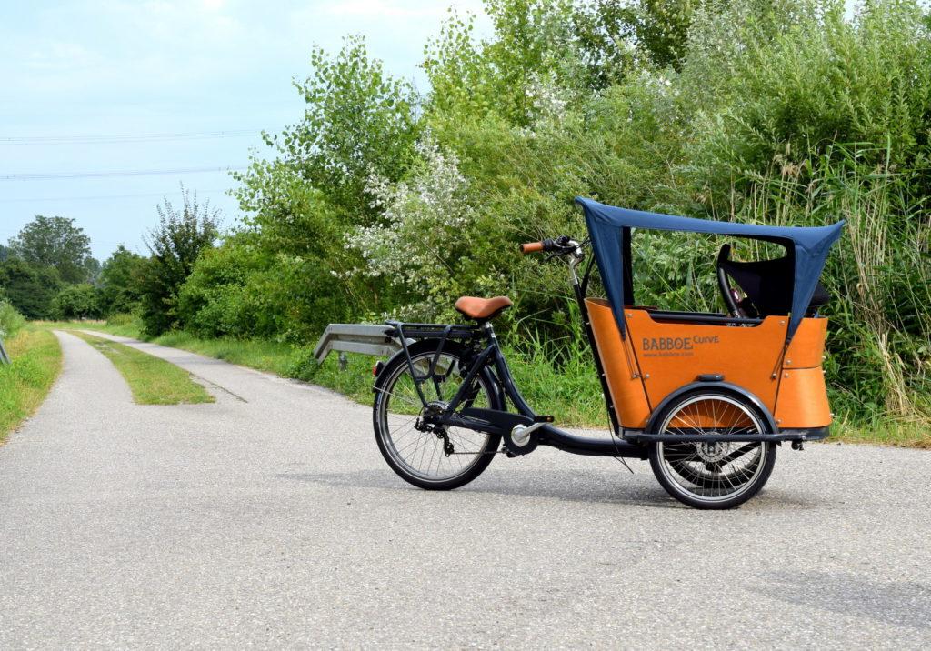 Lastenfahrrad haben wir uns für die Fahrrad Tour mit Baby, Kleinkind und Kind gekauft von Babboe Curve-E. Was ist ein Lastenrad? Welche Vorteile?