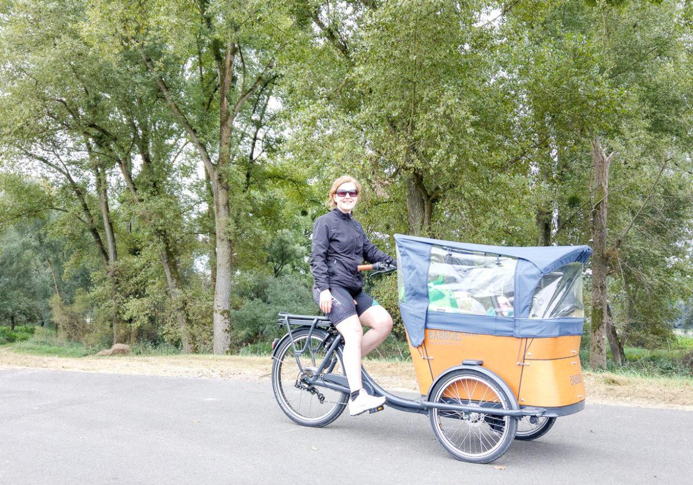 Babboe Curve-E Lastenfahrrad Erfahrung Fahrrad fahren am Rhein mit Baby mehrere Tage Fahrradurlaub