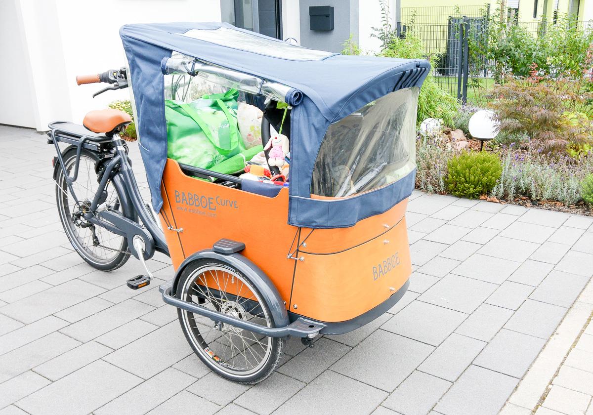 Erfahrung Babboe Curve-E Lastenrad Baby vorne Radtour mehrere Tage packen für Kind und Eltern im Lastenfahrrad