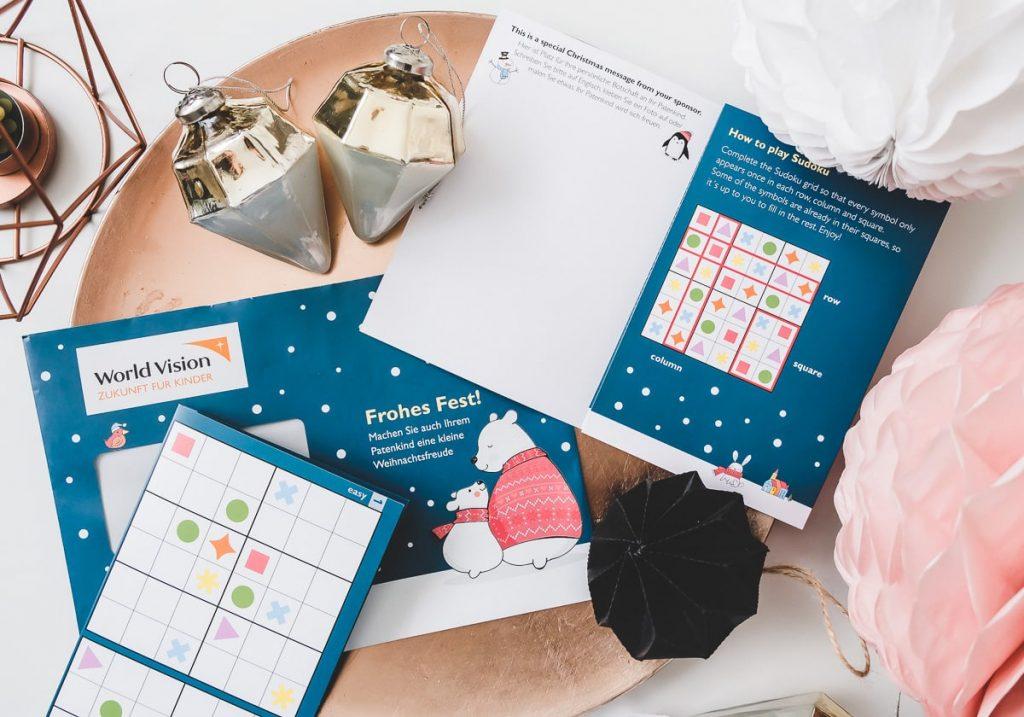 World Vision Weihnachtskarte für Patenkinder mit Sudoku Spiel